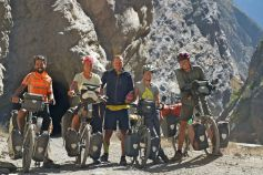 Five cyclists heading south through Canyon Del Pato
