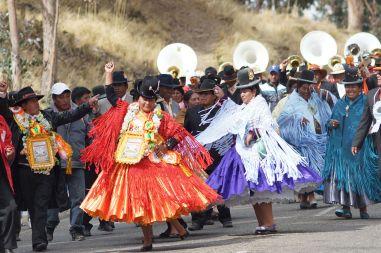 Fiesta dancers on road to La Paz